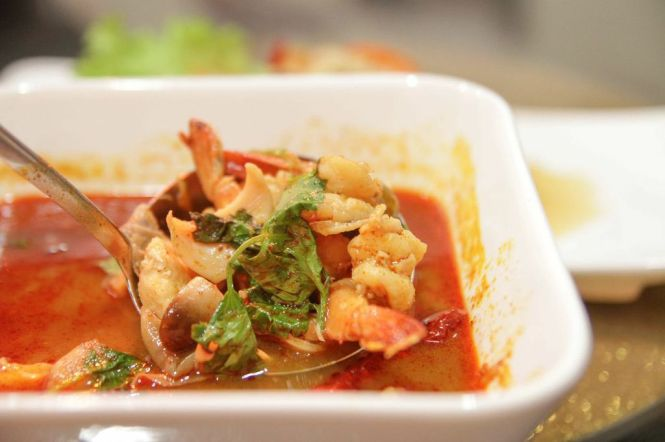 Tom Yum Talay. Hot & Spicy Seafood Soup with Thai Herbs :: $8.80 / $14.80